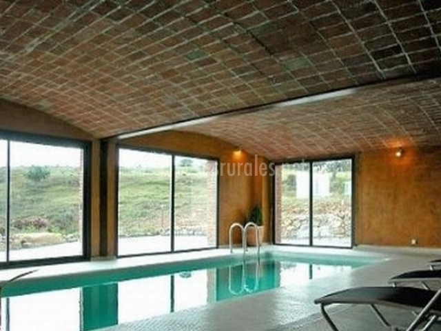 El niu en capolat barcelona for Casas rurales en asturias con piscina climatizada